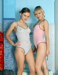 Two teenage lesbian beauties sharing a super long dildo