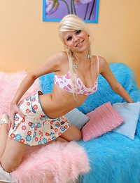 Cute lipstick smudging blonde teenager plays with herself