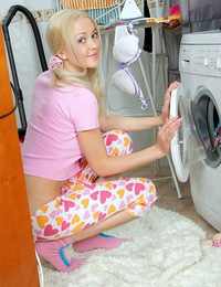 Teenage blonde doing her laundry and petting her coochie